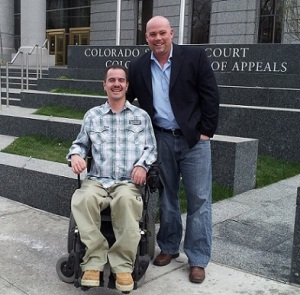 Attorney Michael D. Evans with client Brandon Coats